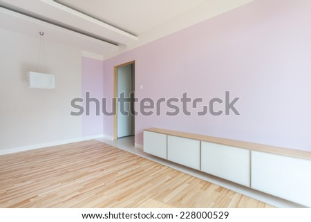 Spacious empty room in pastel colors and dropped ceiling - stock photo