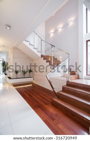 Spacious hall and stairs in luxury house - stock photo