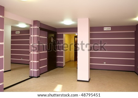 Spacious hall with a column and a mirror - stock photo