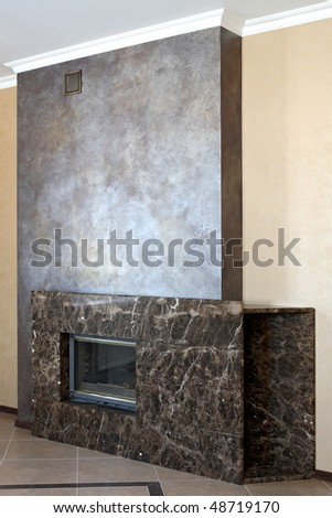 Spacious hall with the big fireplace - stock photo