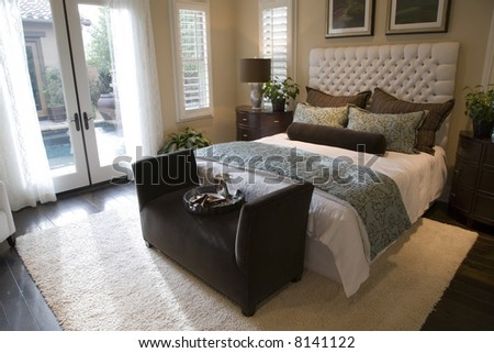 Spacious home with comfortable bedroom and modern decor. - stock photo