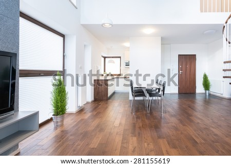Spacious interior of dinning room in modern house - stock photo