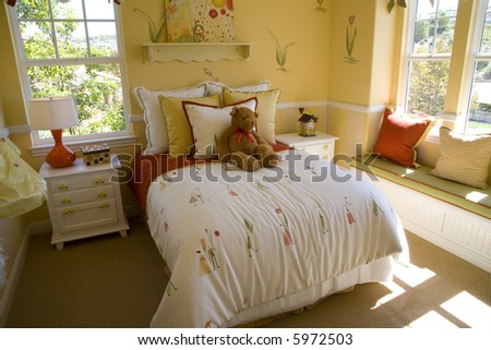 Spacious kids bedroom with colorful objects and pillows. - stock photo