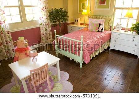 Spacious kids bedroom with toys.