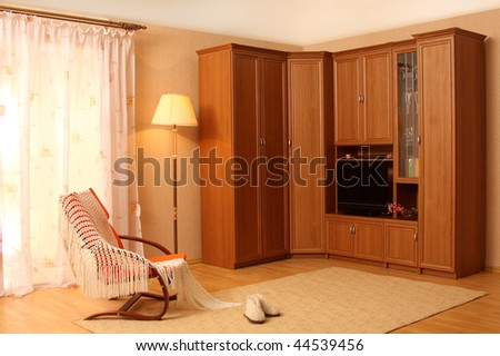 Spacious living room with a window - stock photo