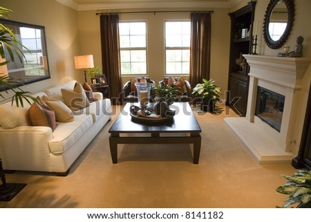Spacious living room with fireplace and stylish decor. - stock photo