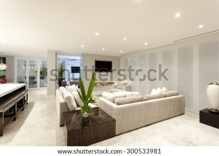 Spacious living room with gray sofas and beautiful lighting