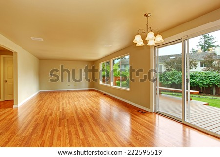 Spacious living room with hardwood floor. Room with exit to backyard wooden deck