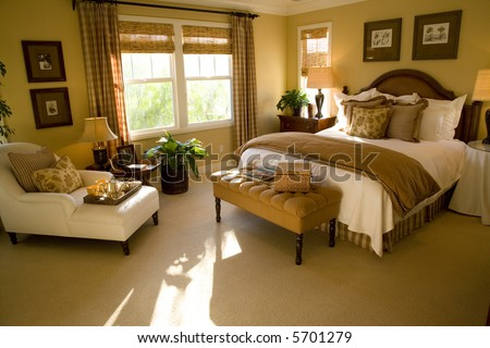 Spacious luxury bedroom with lounge area. - stock photo