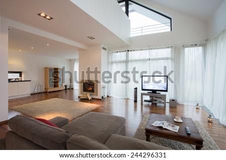 Spacious luxury living room in exclusive villa - stock photo