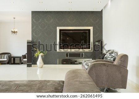 Spacious luxury living room with movie theater - stock photo
