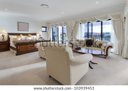 Spacious master bedroom in luxury house overlooking the water