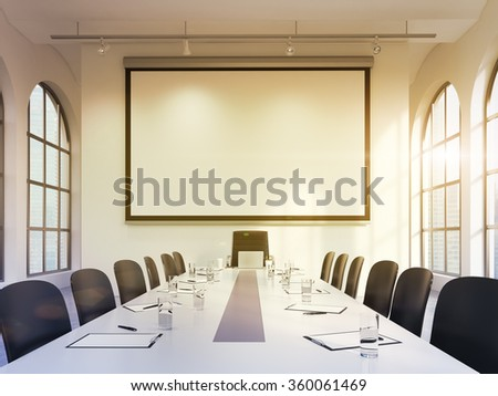 spacious meeting room in office building, big windows on two sides, big white table and black leather armchairs around, lamps above. blank screen on the back wall. Filter. Concept of negotiations - stock photo