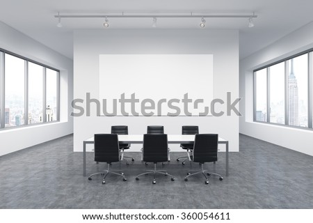 Spacious meeting room in office building, windows on both sides, New York view, big white table and six black leather armchairs around it. White board on the back wall. Concept of negotiations - stock photo
