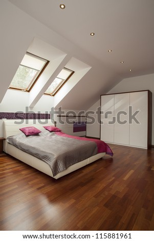 Spacious modern bedroom with pink pillows - stock photo