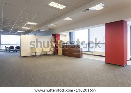 Spacious office interior and a reception lobby - stock photo