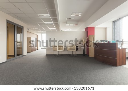 Spacious room in an office building, modern interior - stock photo