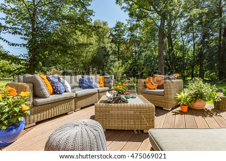 Spacious villa patio with comfortable stylish rattan furniture set