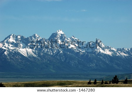 spacious vista of the Grand Teton from the National Elk Refuge - stock photo
