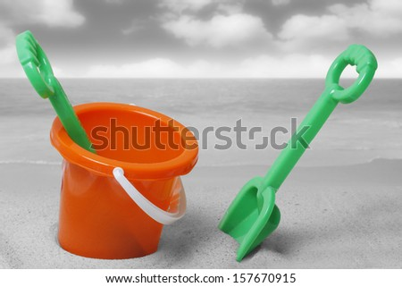 spade and bucket on a beach  - stock photo