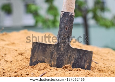 Spade in the sand - stock photo