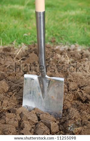 Spade in the soil - stock photo