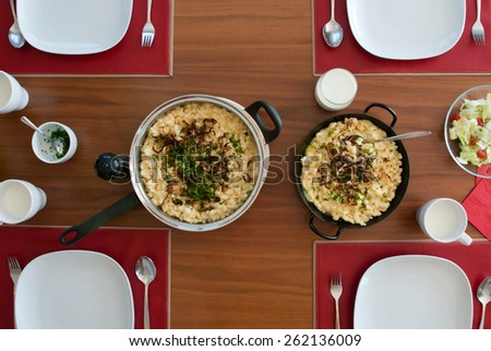 spaetzle with melted cheese in pan -  - stock photo