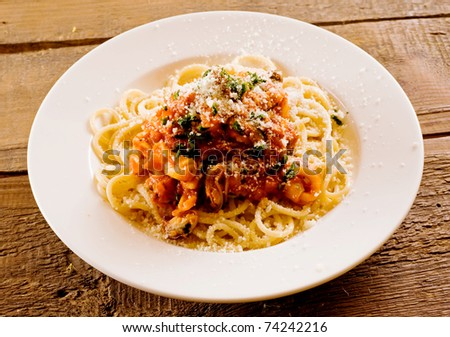 Spagetti with seafood. Shallow depth of field. - stock photo