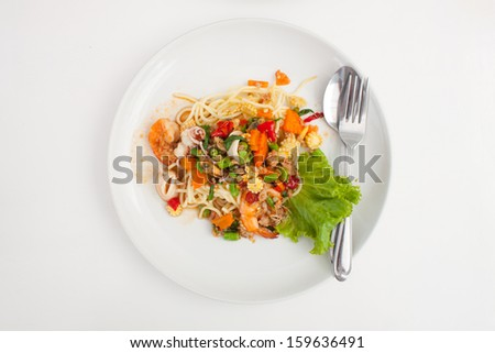 spaghetti and fried basil and vegetables in isolated white background on top view - stock photo
