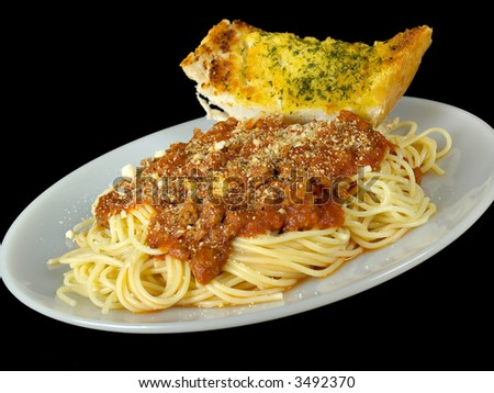 Spaghetti and Garlic Bread isolated on a black background - stock photo