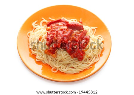 Spaghetti and meat with ketchup in orange plate - stock photo