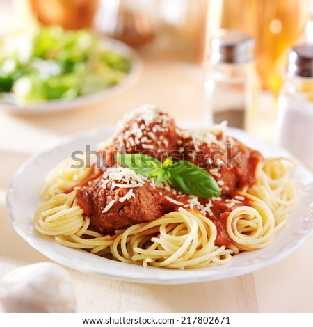 spaghetti and meatball dinner with salad - stock photo