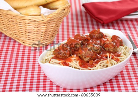 Spaghetti and meatball meal with garlic breadstick - stock photo