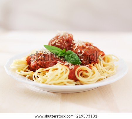 spaghetti and meatballs on empty table - stock photo