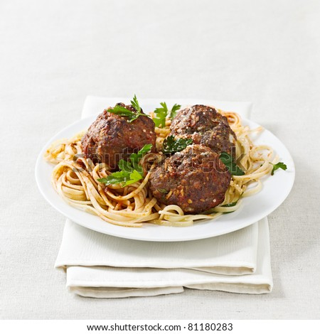 spaghetti and meatballs with copyspace composition. - stock photo