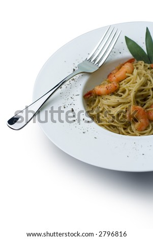 Spaghetti and prawns in a cream sauce, herb garnish. On a deep white, round bowl with wide rim sprinkled with ground pepper. Includes clipping path to change background and isolate from shadow. - stock photo