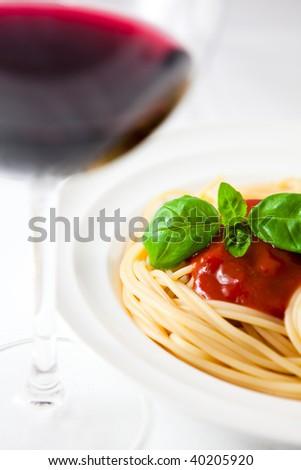 Spaghetti and red wine - stock photo