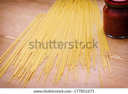 Spaghetti and tomato sauce on the table - stock photo