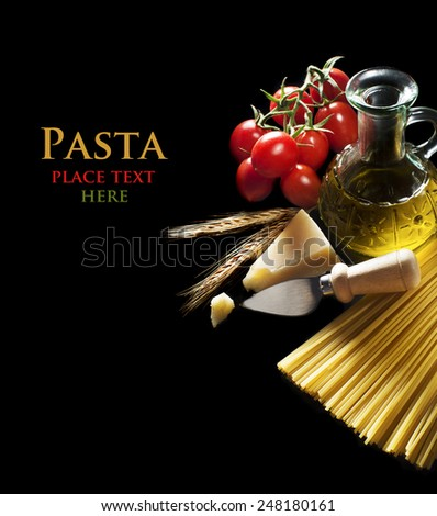 Spaghetti and tomatoes with parmesan cheese on black background - stock photo