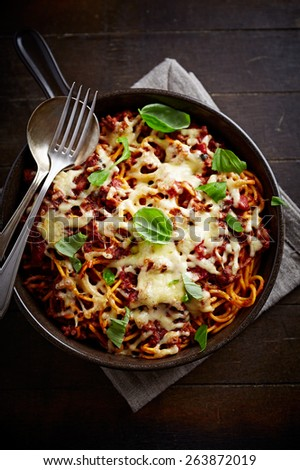 Spaghetti baked with cheese and tomato sauce  - stock photo