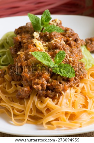 Spaghetti bolognese and mint on the plate  - stock photo