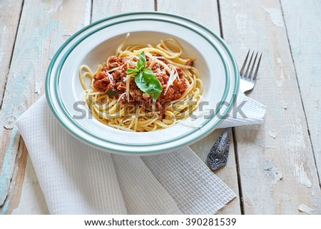 Spaghetti bolognese in early morning light - stock photo
