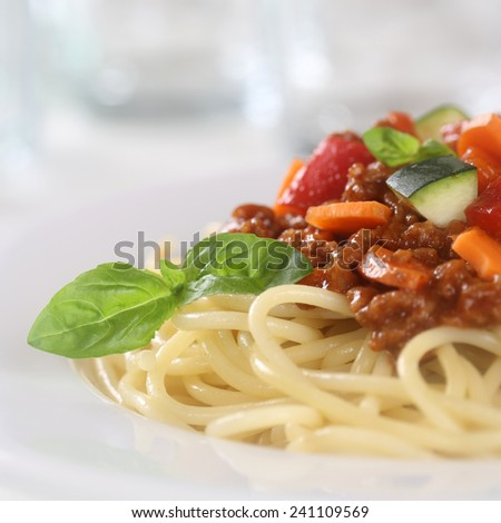 Spaghetti Bolognese noodles pasta meal on a plate with meat and vegetables - stock photo