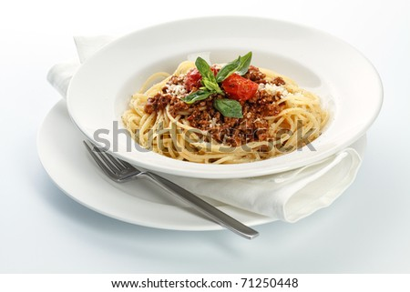Spaghetti Bolognese on white background - stock photo