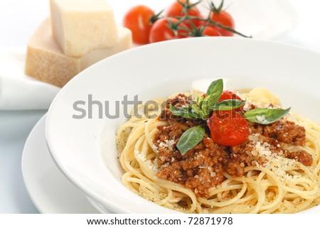Spaghetti Bolognese on white background - stock photo