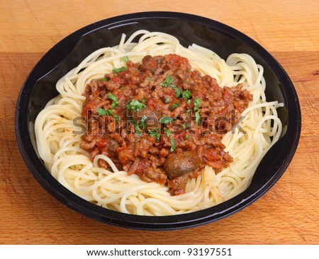 Spaghetti bolognese ready meal in plastic tray - stock photo