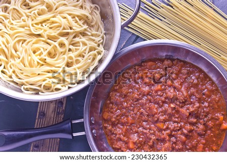 Spaghetti bolognese sauce in pan - stock photo