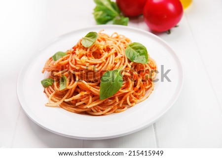 spaghetti bolognese with basil and parmesan cheese - stock photo
