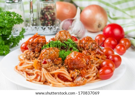Spaghetti bolognese with beef meatballs and parsley - stock photo
