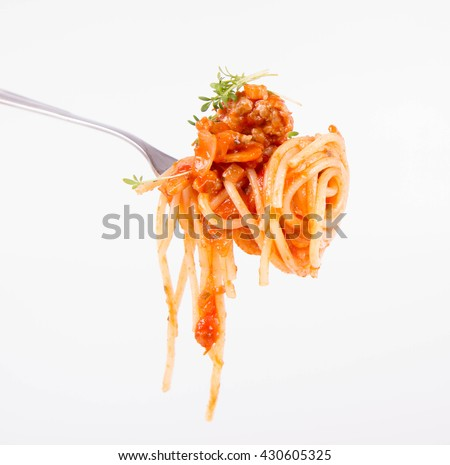 Spaghetti bolognese with garlic on a fork - stock photo